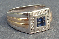 Tammy's Jewelry and Gem Box. Gold ring with saphires and diamonds.