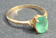 Tammy's Jewelry and Gem Box. Gold ring with emerald.